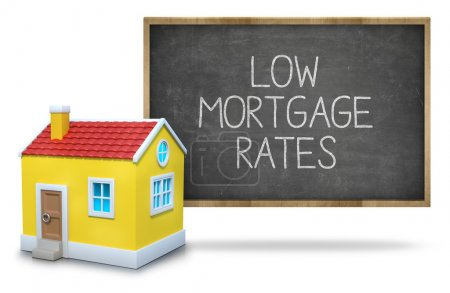 Low mortgage rates text on blackboard with 3d house