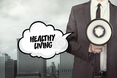 Healthy living text on speech bubble with businessman and megaphone