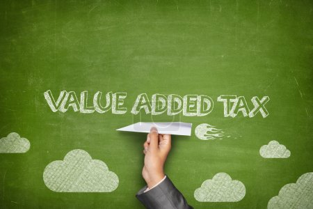 Value added tax concept on green blackboard with b...
