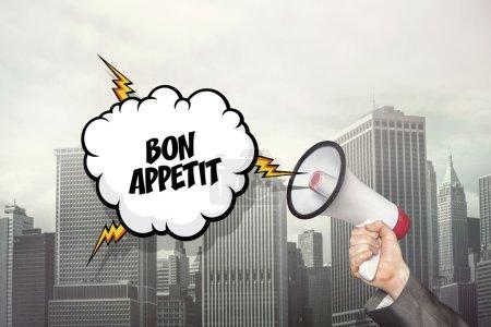 Bon appetit text on speech bubble and businessman hand holding megaphone