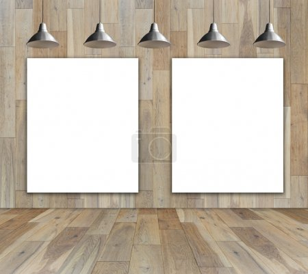 Blank frame on wood wall with Ceiling lamp