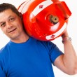 A man wearing a gas cylinder on his shoulder - iso...