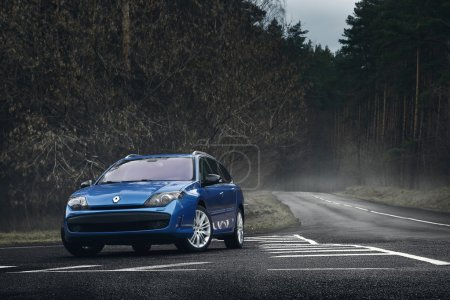 Blue car Renault Laguna standing