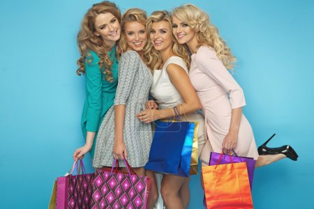 Group of blond cheerful girlfriends