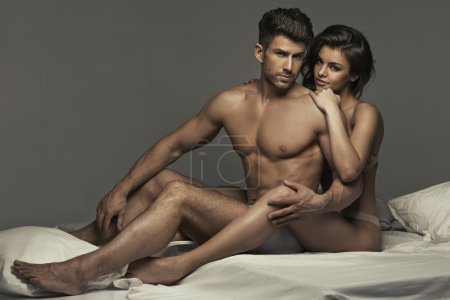 Photo for Muscular handsome guy with his wonderful wife - Royalty Free Image