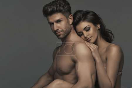 Portrait of the sexy couple in bedroom