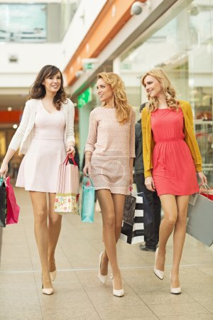 Three beautiful friends in the shopping mall