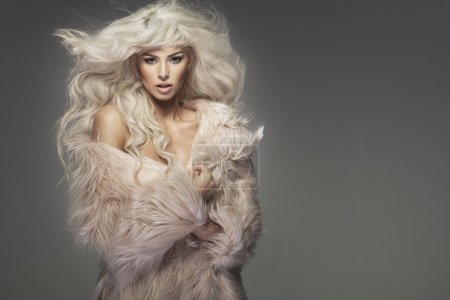 Sensual woman wearing the fur coat