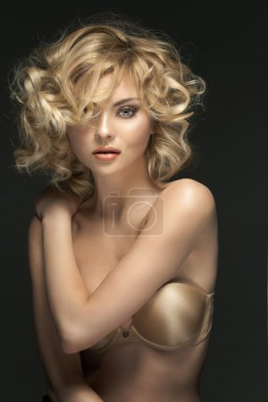 Curly-haired blond woman with fabulous eyes