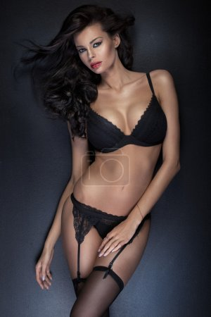 Brunette tawny lady wearing sensual, black lingerie