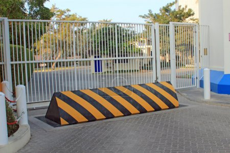 Photo for Yellow and black security barrier in front of security gates symbolizing protection, security and potential threats - Royalty Free Image