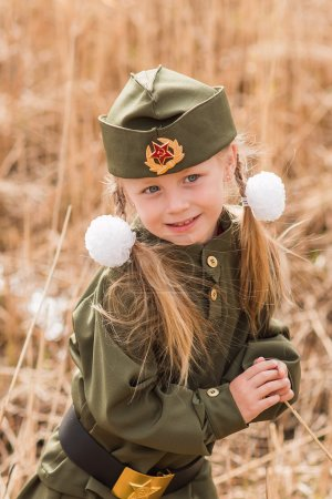 Photo for Portrait of a girl with two plaits and white ribbons in uniform and his cap - Royalty Free Image