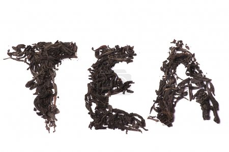 Pinch of loose leaf black tea. Isolated on a white...