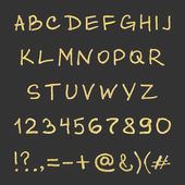 Handwritten gold alphabet