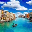 Ancient buildings and gondola along Canal Grande in Venice Italy