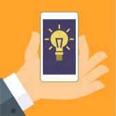 Concept of idea The hand holding the Smartphone with a light bulb Flat vector illustration