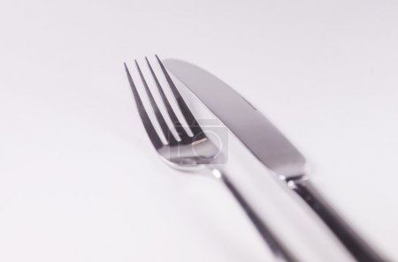 Photo for Pure silver big and small fork, spoon, knife isolated on white background. for food, - Royalty Free Image