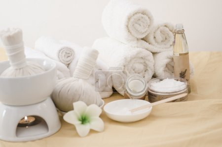 Spa treatment with towels and herbal creams