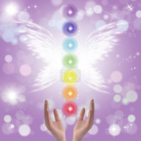 Photo pour Healing Hands et sept chakras sur fond pastel étincelant - image libre de droit