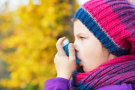 Girl Using Inhaler on a autumn day