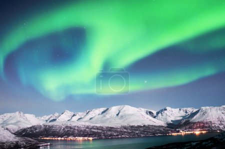 Northern lights above fjords in northern Norway