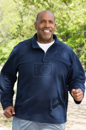 Mature African American man exercising