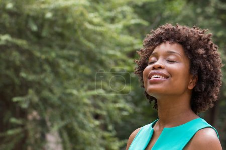 Photo for Portrait of a beautiful African American woman smiling with copy space. - Royalty Free Image