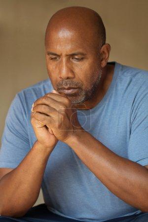 Photo for African American man praying. - Royalty Free Image