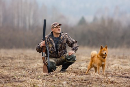 The hunter with a gun and a dog