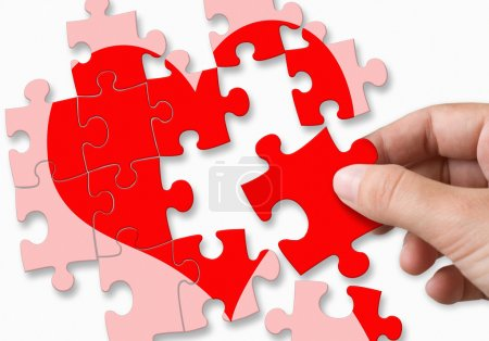 Photo for Red broken heart made by puzzle pieces - Royalty Free Image