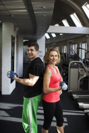 Fitness couple with free weight