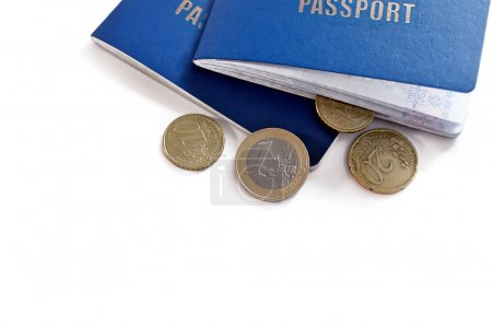 Two passports and euro money coins on white