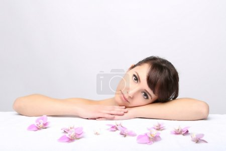 Spa salon. Girl lying on a massage table