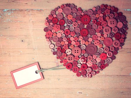 Red heart background on vintage old surface.