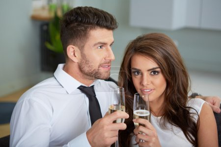 Young couple with champagne glasses