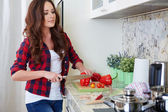 Young Woman Cooking. Healthy Food