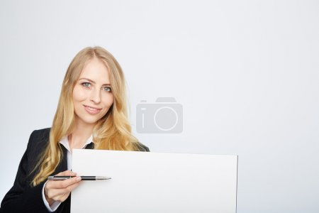 Pretty blonde girl with a blank presentation board