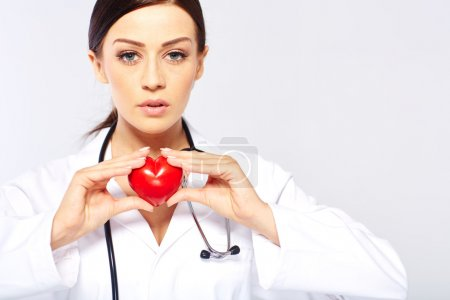 female doctor holding a heart