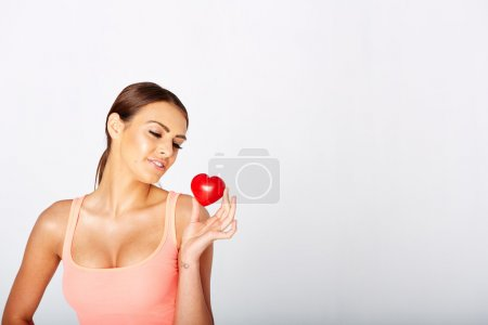 Photo for Heart shape in womans hands. Cardiovascular medicine. Heart or pulse rate concept - Royalty Free Image
