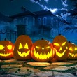 Halloween night background with scary house and cr...