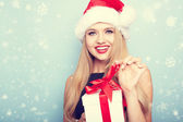 Portrait of beautiful girl with santa hat.