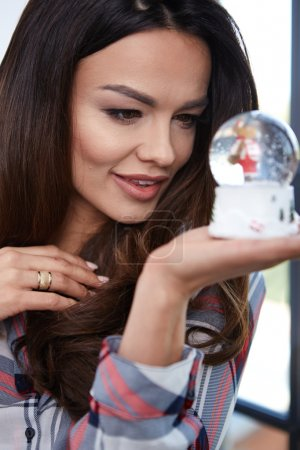 Portrait  woman with a snow globe.