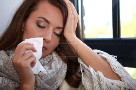 Flu. Closeup image of frustrated sick woman