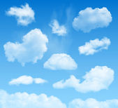 Set of highly detailed realistic vector clouds on a blue sky background