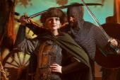 Muž a žena ve středověké brnění