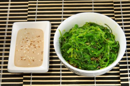 Sushi menu: salad of seaweed with sauce.