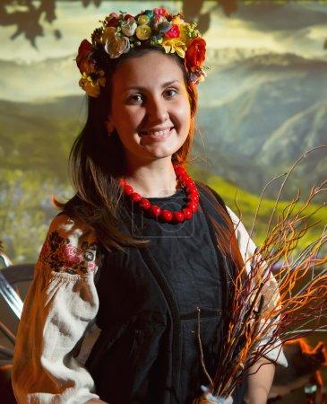 Ukrainian girl in national costume in a flower wreath