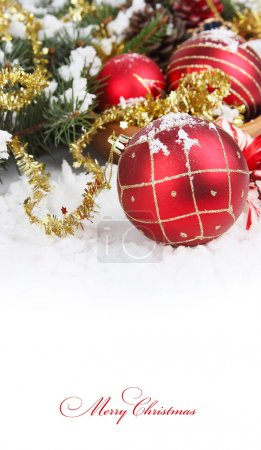 Christmas border with red bauble, golden present and snow