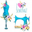 Vintage sewing machine and fashion mannequin isola...