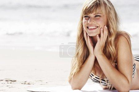 Sunbathing babe on beach